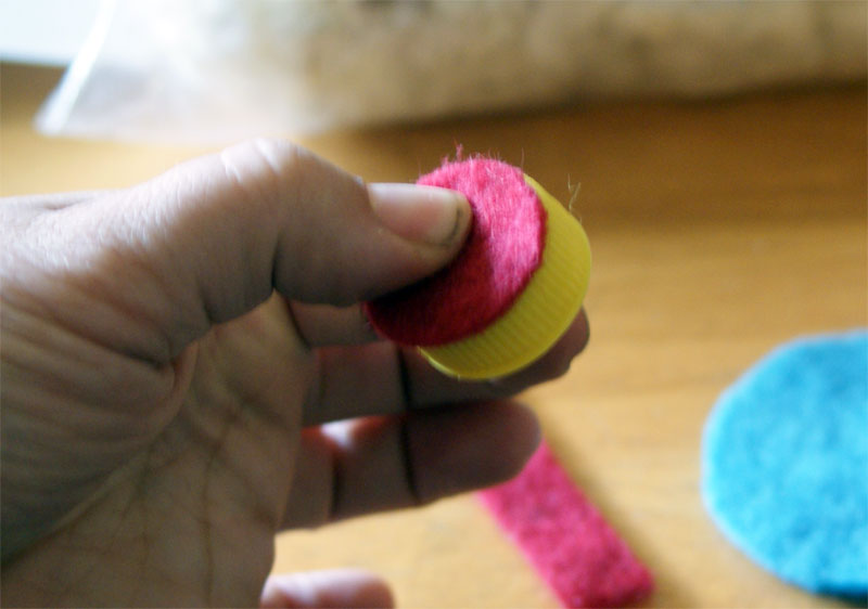 How To Make A Bottle Cap Pincushion from Muse of the Morning